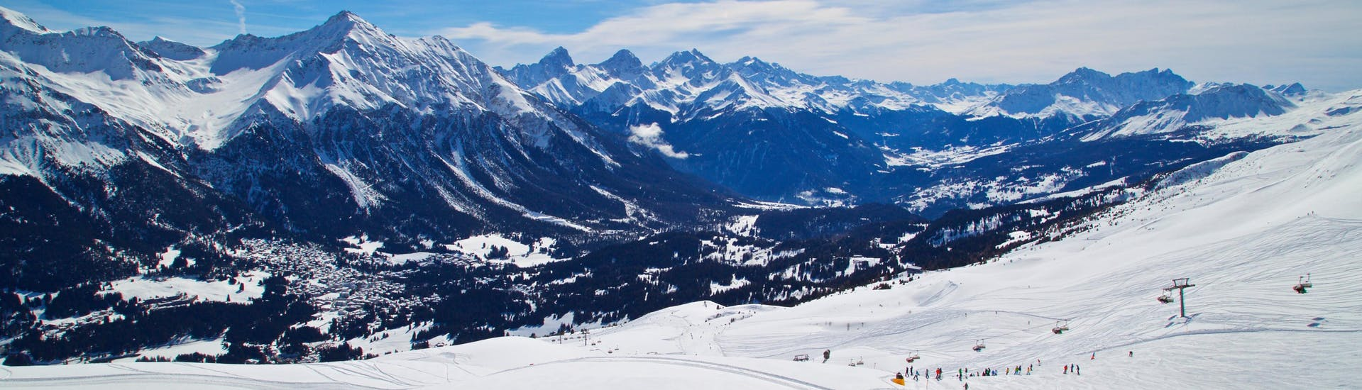 A panoramic view of the entire valley surrounding the popular swiss ski resort of Lenzerheide, where visitors can book ski lessons with one of the local ski schools.