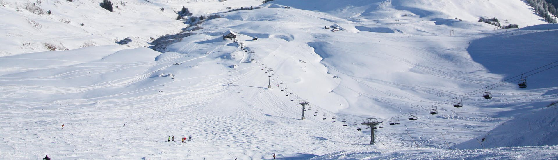 A view of the snowy slopes of the Swiss ski resort Les Crosets-Champoussin, where local ski schools offer a wide range of ski lessons to those who want to learn to ski.