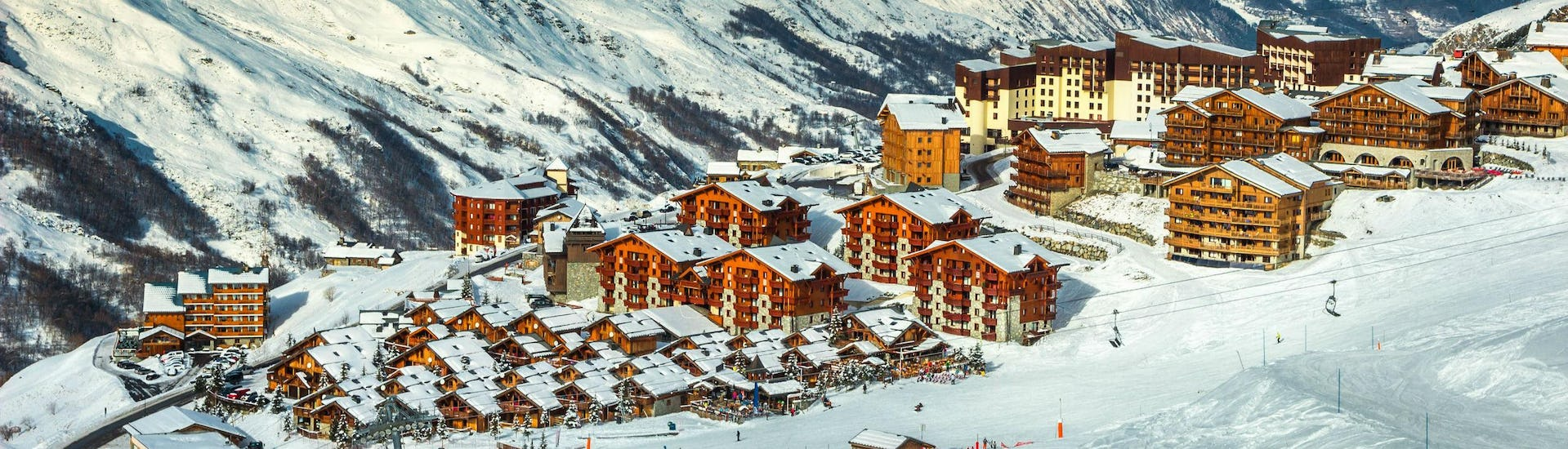 A view of the French ski resort of Les Menuires in the Les Trois Vallées ski region, where local ski schools offer ski lessons for snow sports enthusiasts who want to learn to ski.