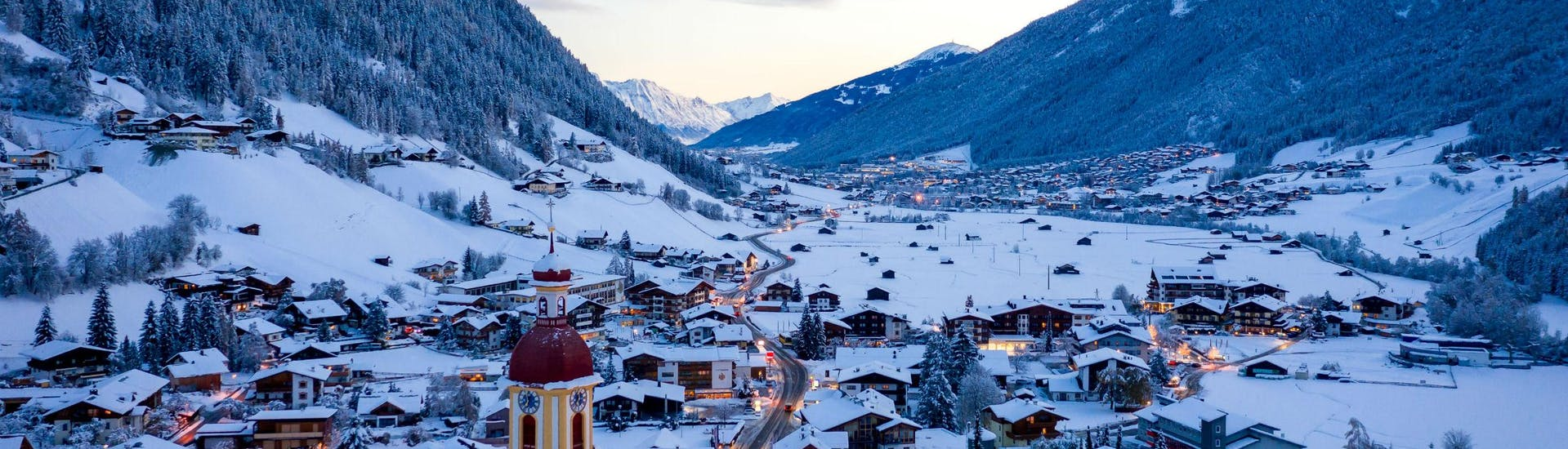 An image of the the tyrolean village of Neustift in the Stubai Valley, where local ski schools offer ski lessons to those who want to learn to ski.