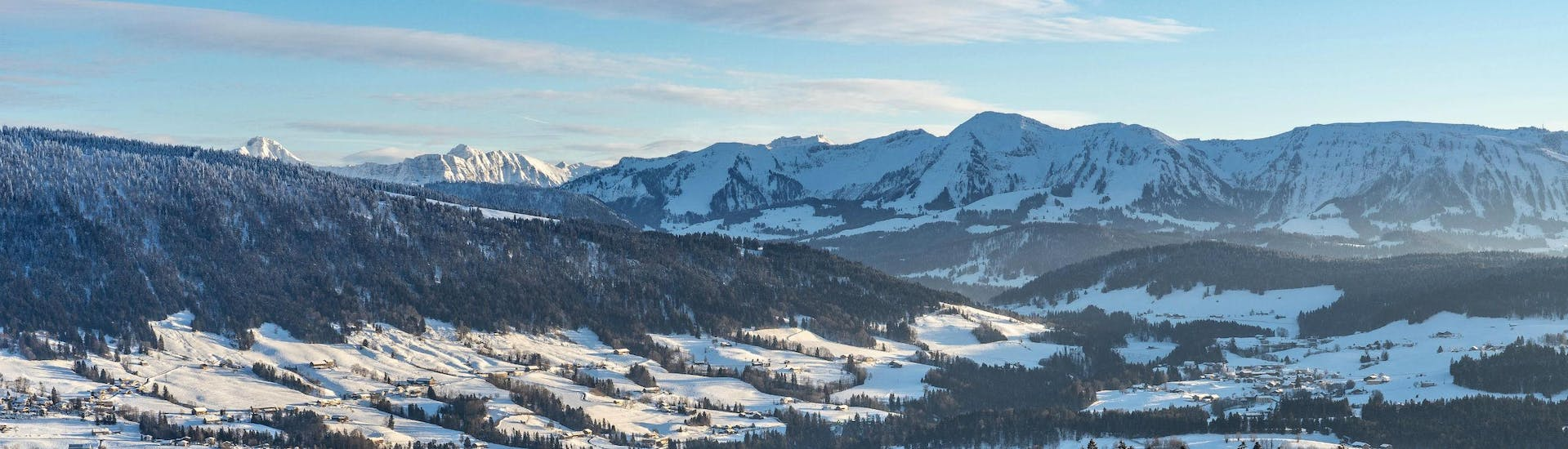 A view of the scenic ski resort of Oberstaufen, where local ski schools offer ski lessons for all experience levels.