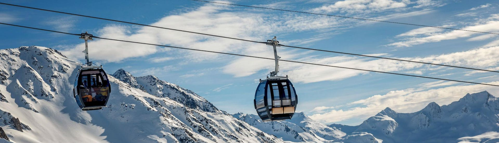 A view of the cable car carrying skiers up to the top of the mountain in the ski resort of Sedrun-Dieni-Oberalp, where local ski schools offer a selection of ski lessons.