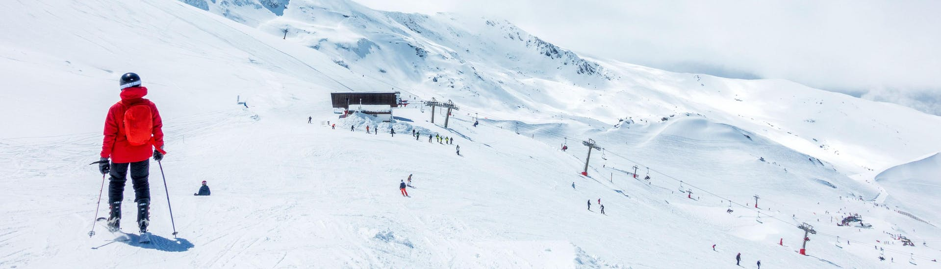 Skiers from different ski schools on the slopes on a sunny day in the ski resort Sierra Nevada, Andalusia.