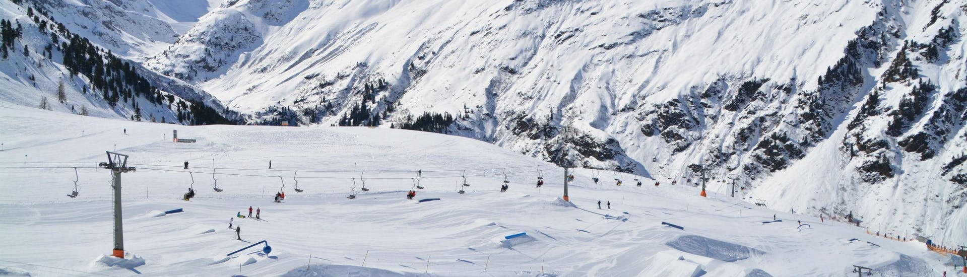 "A view of the ski slopes in St. Anton, also known as the ""cradle of alpine skiing"", where local ski schools organise ski lessons for winter sports enthusiasts who want to learn to ski."