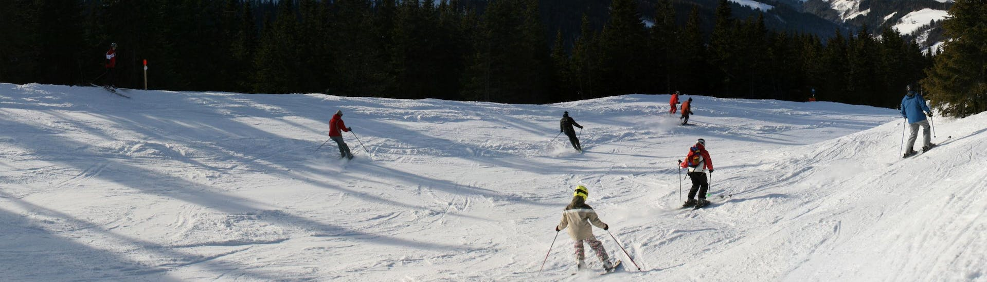 Several skiers are enjoying themselves on one of the ski slopes in the ski resort Stuhleck, where local ski schools offer different types of ski lessons.