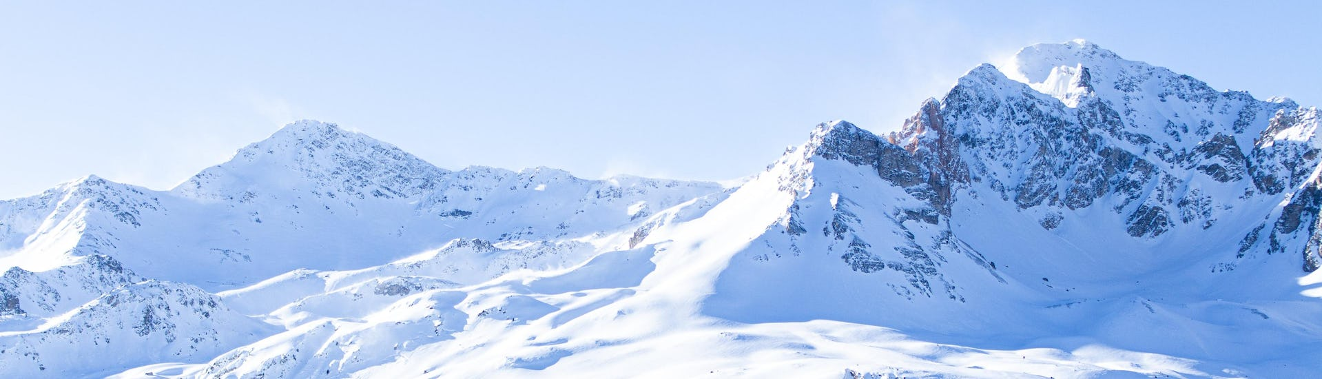 A scenic view of the snow-capped mountains surrouding the French ski resort of Valfréjus where local ski schools offer a large choice of ski lessons.