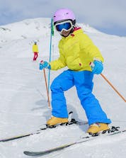 An image of a young child skiing down a race course during their ski lessons with one of the local ski schools in Prato Nevoso.
