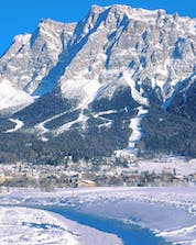 An image of the Tiroler Zugspitz Arena on the Austrian side of the Zugspitze mountain, a popular place to learn to ski by taking ski lessons with one of the local ski schools.