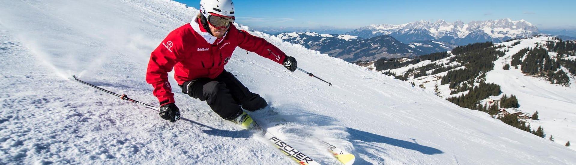A ski instructor of the ski school Skischule Kitzbühel Rote Teufel is enjoying the freshly groomed slopes of the Kitzbühel ski resort.