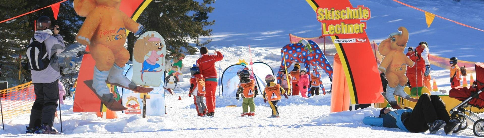 Several children are enjoying themselves in the Kinderland area during their kids ski lessons with the ski school Skischule Lechner in Zell am Ziller.