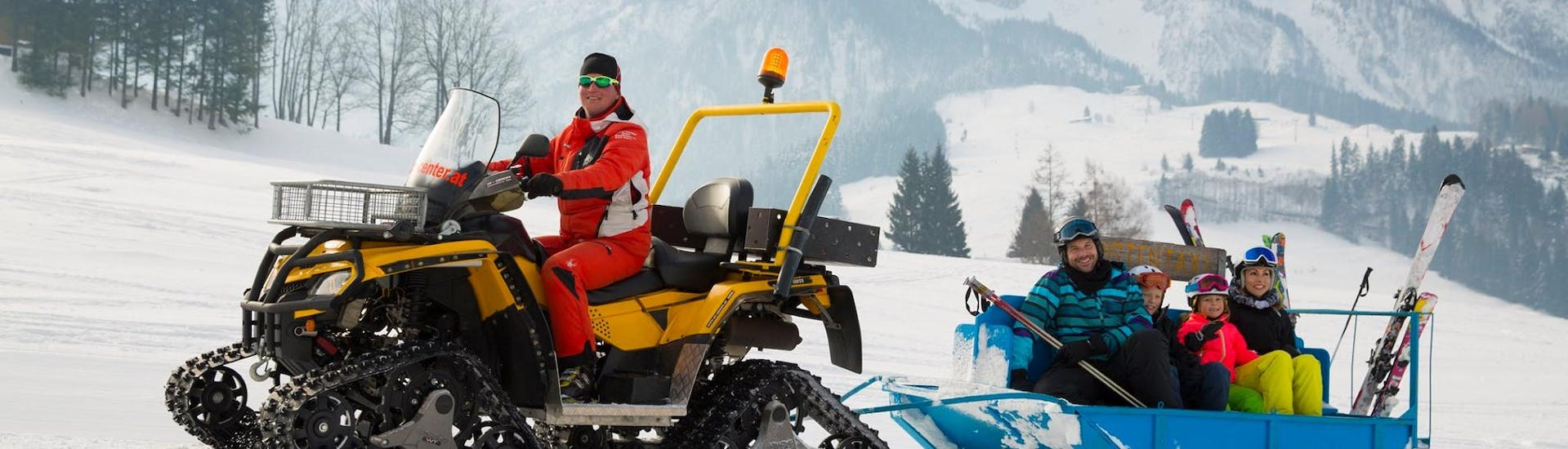The Ski instructor of Skischule Zahmer Kaiser  in Kaiserwinkel drives around the participants from his skiing lessons with his snowmobile.
