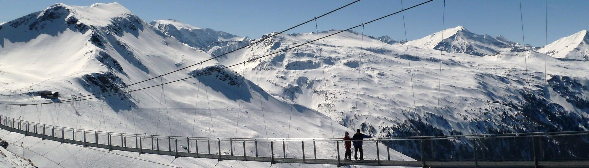 View over the sunny mountain landscape while learning to ski with the ski schools in Bad Hofgastein.