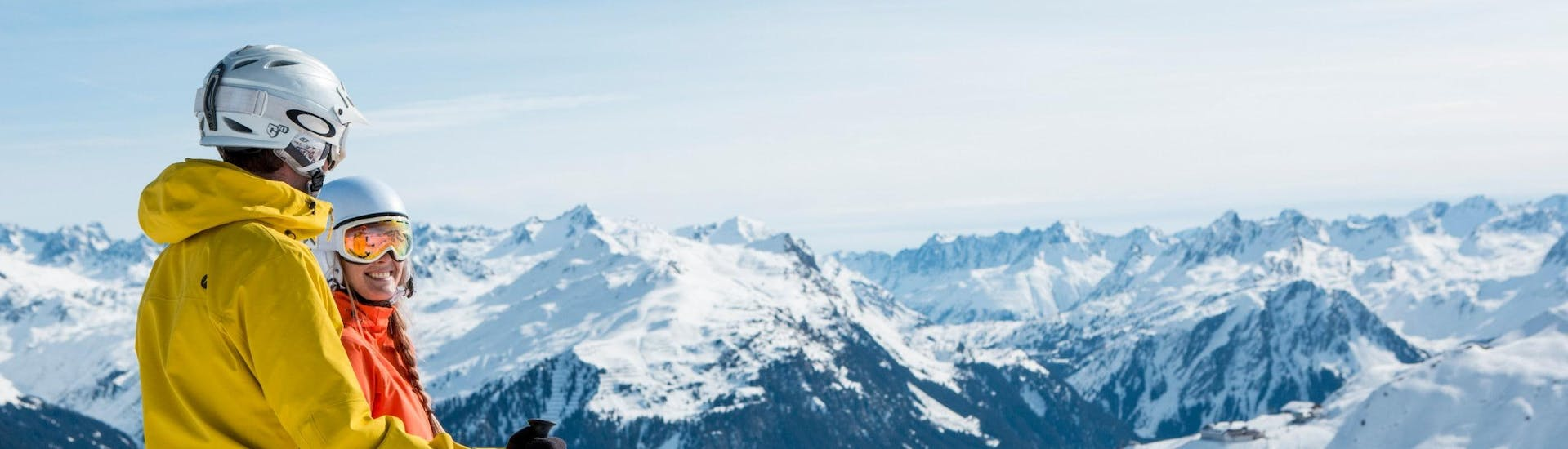 View over the sunny mountain landscape while learning to ski with the ski schools in Silvretta Montafon.