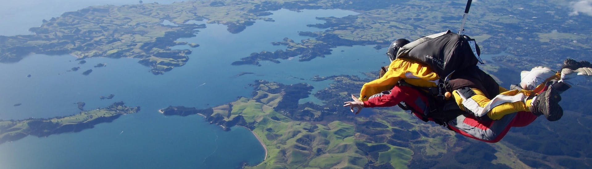 A participant of the skydive organized by Skydive Bay of Islands is living the time of her life in Bay of Islands.