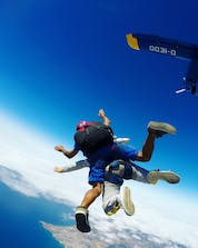A photo from a tandem jump who just jumped out of the plane over the coast in Portugal where you can do skydiving in Alvor.