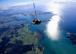 A skydiver is free falling at a speed of 200 km per hour during the Skydiving in Bay of Islands -  16,000 ft or 20,000 ft organized by Skydive Bay of Islands.