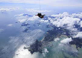 A skydiver is having the time of his life during the Skydiving in Bay of Islands -  9,000 ft or 12,000 ft organized by Skydive Bay of Islands.