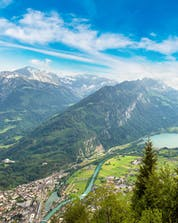 A beautiful view from the valley where you can do skydiving in Interlaken.