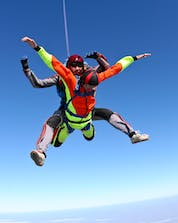 A young man and his tandem master are pictured mid-jump while skydiving in Tallard.