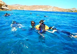 A family enjoying their Snorkeling Adventure Tour in Mykonos together with a local guide from the Mykonos Diving Center.