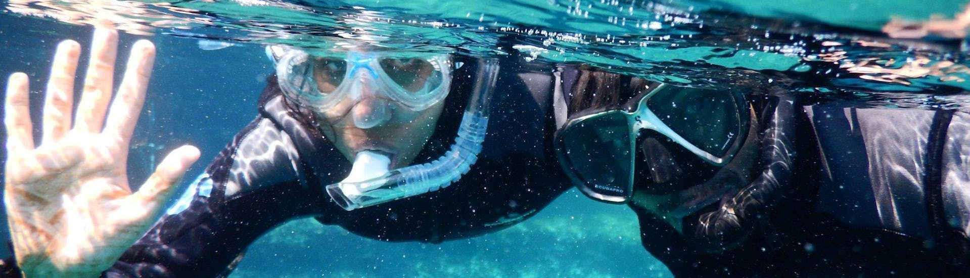 Two people enjoying their Snorkeling Adventure at Mykonos together with an experienced instructor from the Mykonos Diving Center.