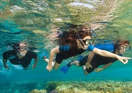 A group of children is exploring the Mediterranean seabed while Snorkeling near Cannes with the Dive Centre La Rague.