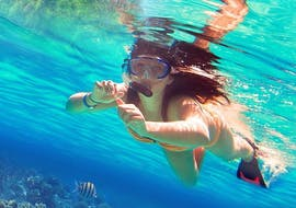 A woman enjoys the unrestricted view of colorful marine life while Snorkeling in Jávea with Four Divers Jávea.