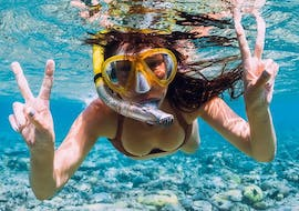 A girl is admiring the vibrant marine life during the Snorkeling in Gold Coast - Cook Island organised by Gold Coast Dive Centre.