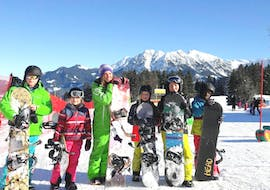 Children are having lots of fun during the Snowboarding Lessons for Kids - All Levels with their friendly instructor from the school Alpin Skischule Oberstdorf.