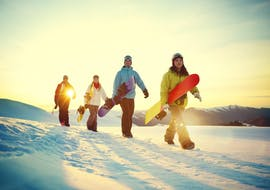 A group of snowboarder during Snowboard Lessons (from 9 years) for All Levels, with the ski school Skischule Kahler Asten.