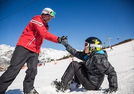 The snowboard instructor from Sertorelli Ski School Bormio is with the participant during the private snowboarding lesson for kids and adults.