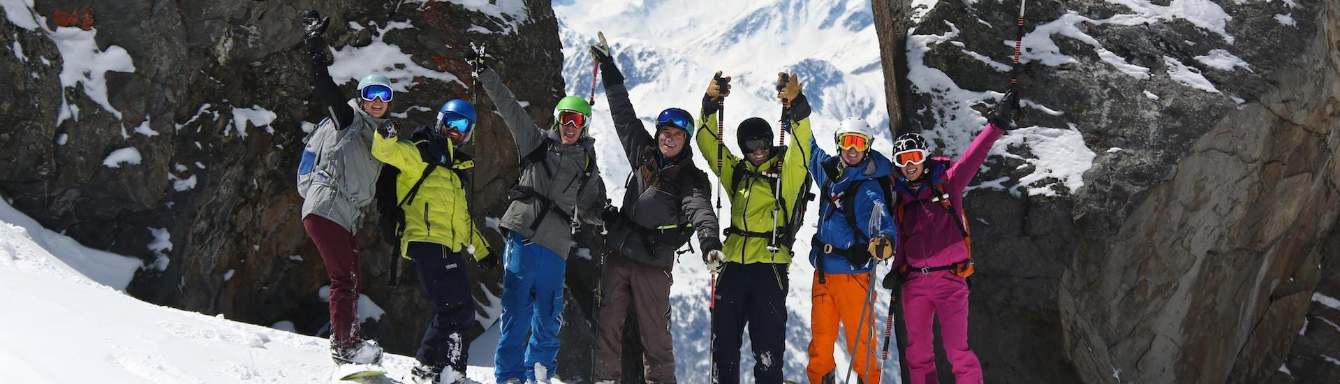 Two snowboarders are taking picture with friends during the Snowboarding Lessons for Adults - All Levels organised by the school Prosneige Val d'Isère.