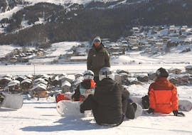 Three kids rest at the end of the Snowboarding Lessons for Kids & Adults - Low Season of the ski school Scuola di Sci e Snowboard Livigno Italy.