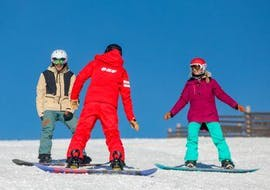 Snowboarders are listening to the instructions of their snowboarding instructor from the ski ESF du Dévoluy while attending their Snowboarding Lessons (from 8 years) - All Levels.