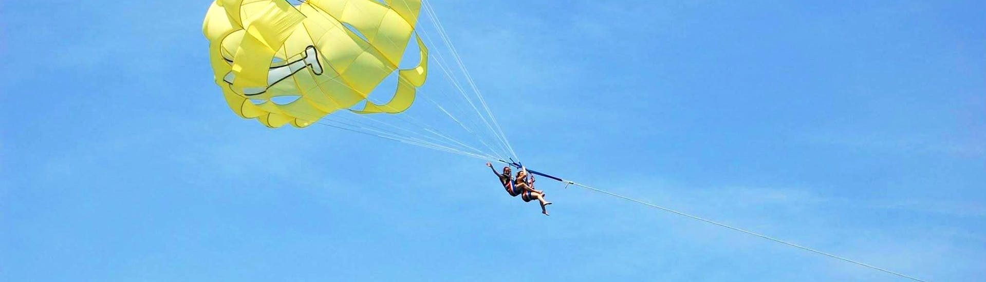 Friends are having fun while Parasailing in Villeneuve-Loubet with Plage des Marines.