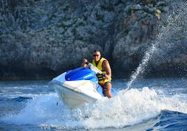 A person is participating to Jet Ski Hire in Agia Marina activity with Cactus Water Sports Center.