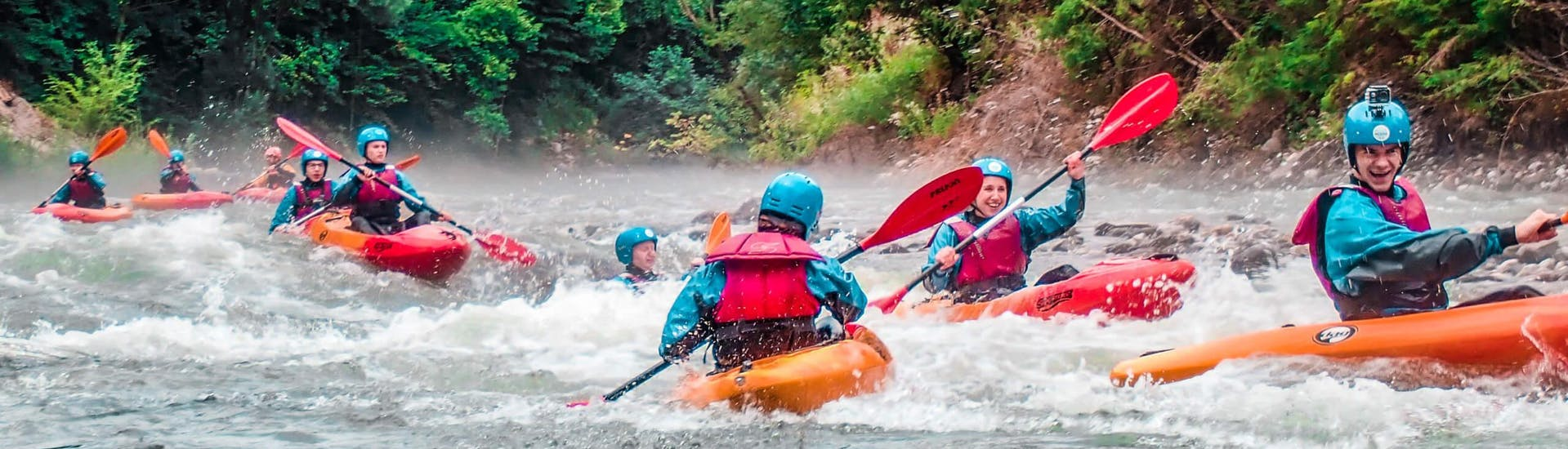 """A group oof kayaketrs is paddling on the river during Sit On Top Kayak Tour """"Classic"""" - Savinja organized by Funpark Menina"""