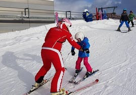 """A ski instructor teaches a kid during a Kids Ski Lessons """"Miniclub"""" (2-6 y.) in Campo Tures - Sand in Taufers."""