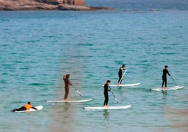 A group of tour participants enjoy the beautiful views from the sea during their Stand Up Paddling Rental at Playa de A Lanzada , organized by Prado Surf A Lanzada.