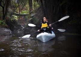 Two participants of Steaming Kayak Rotorua - Waikato River organized by Paddle Board Rotorua are kayaking admiring the nature of the Waikato River.