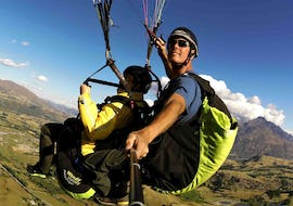 A tandem master and his passenger are enjoying the view while Paragliding in Queenstown - Summer with Skytrek Queenstown.