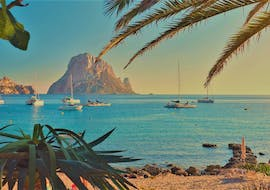 View of the coast of Ibiza during a sunset boat trip with Take Off Ibiza.