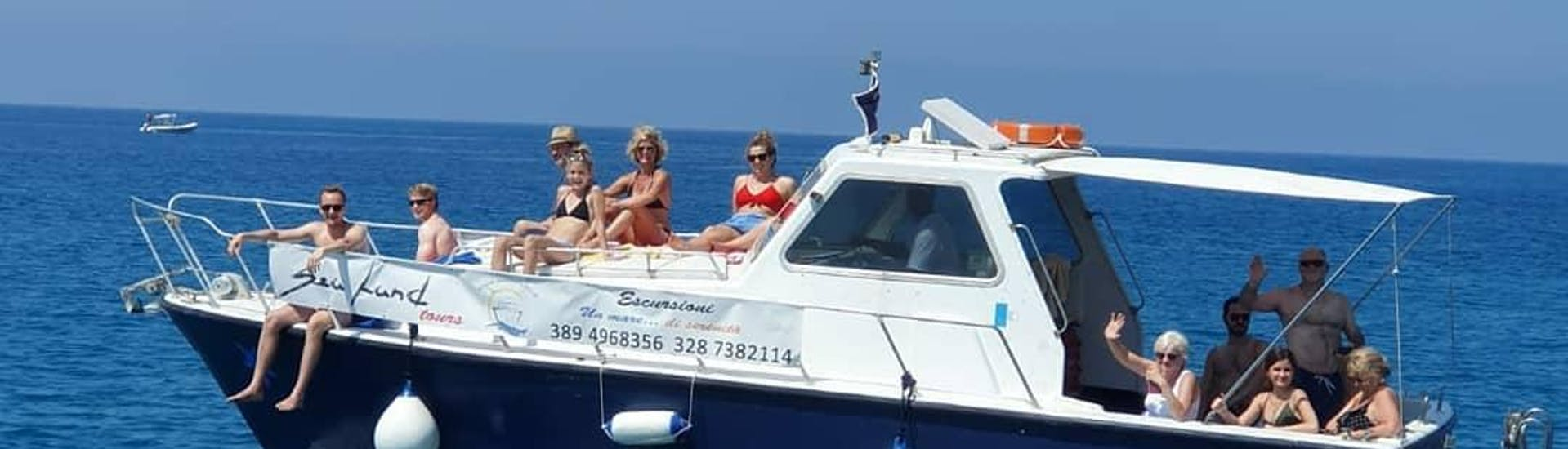 During a Sunset Boat Trip in Cefalù with Sightseeing with Sea Land Tours Cefalù passengers have fun sitting on the boat.