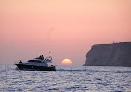 Our boat Liliana sailing across the sea during our sunset boat trip around Lampedusa with dinner, organised by Gita in Barca Liliana Lampedusa.