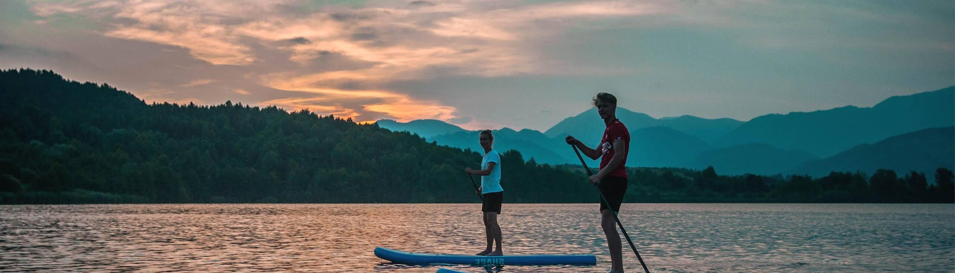 Watching magical sunset during Stand Up Paddle Sunset Tour - Lake Velenje organized by Funpark Menina