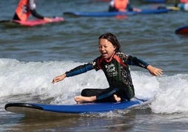 A kid is having fun during Surfing Lessons - Hendaye Beach - Beginner activity with Gold Coast Hendaye.