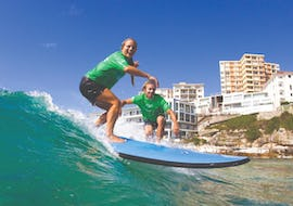 During the Surfing Lessons in Bondi Beach for Teens & Adults - Beginner, a couple is learning how to surf under the supervision of an experienced surf instructor from Let's Go Surfing.
