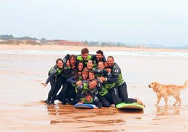 A group of surfers throw themselves together for a great group photo for Latas Surf during their Surfing Lessons incl. video analysis - All Levels & Ages.