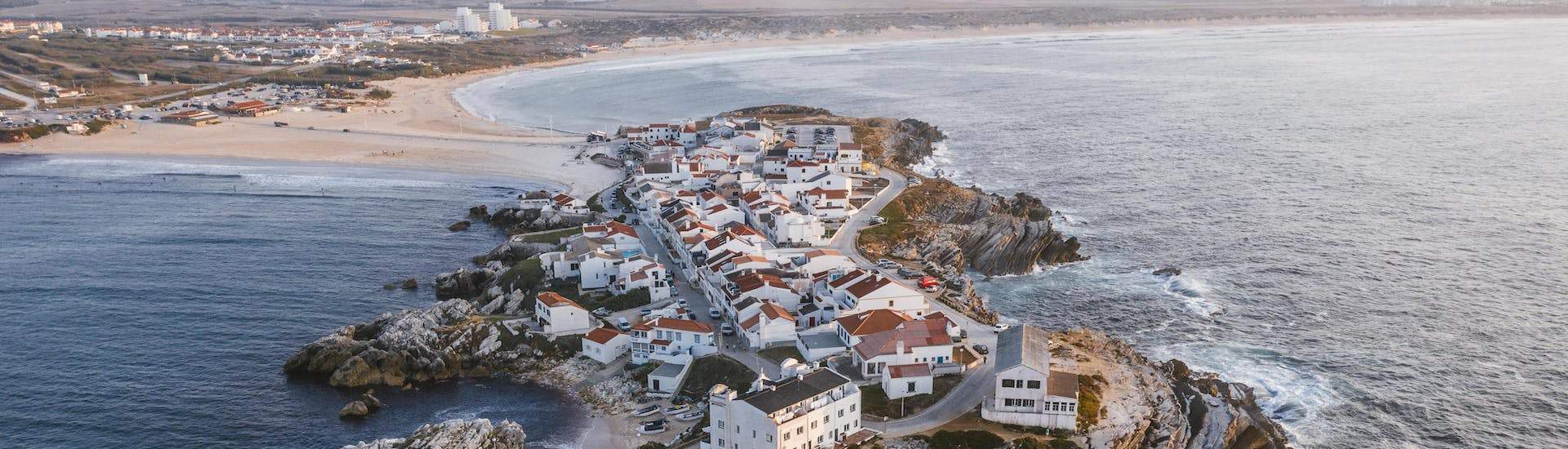 An areal view of the rocky peninsula that can be seen by visitors who go surfing in Peniche.