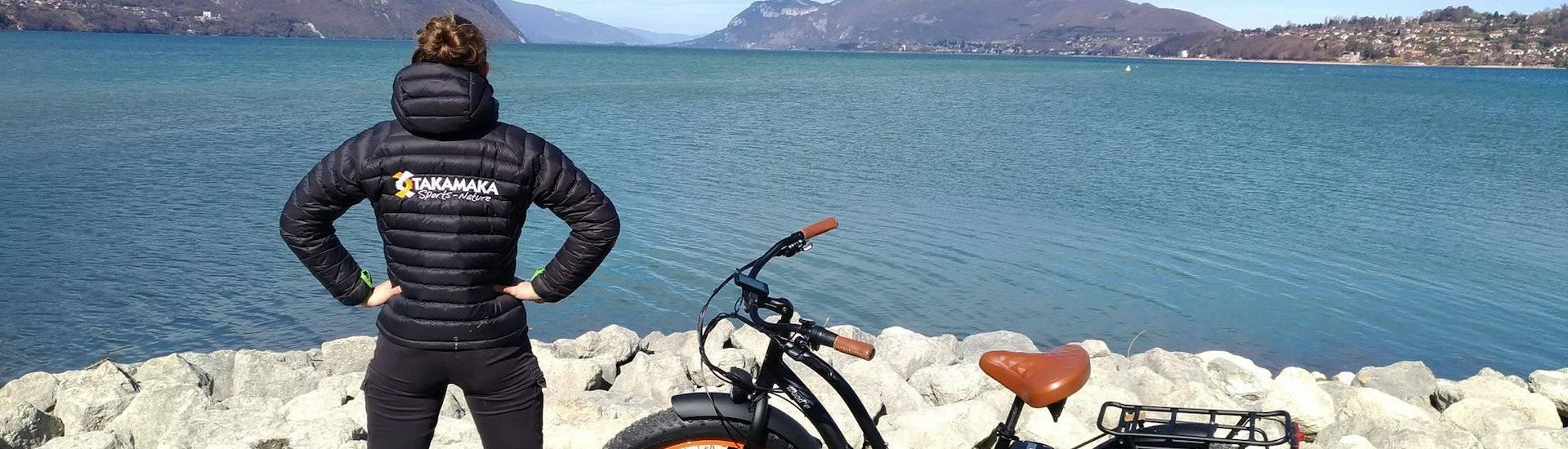A local guide from Takamaka Aix Les Bains is contemplating the Lac du Bourget around which a lot of outdoor activities such as paragliding and canynoning take place.